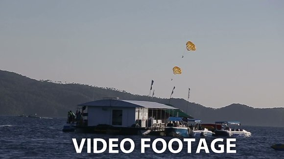 Parachute flying over the ocean. in Graphics