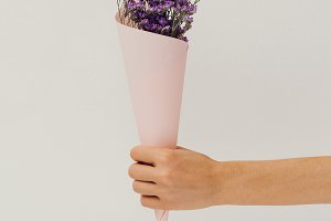 Hand holding Field Flowers