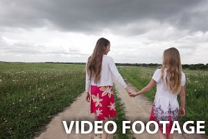 Young girls walking on field