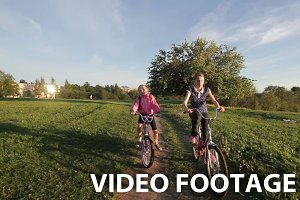 Girls riding bicycle