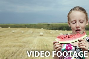 Girl eat watermelon