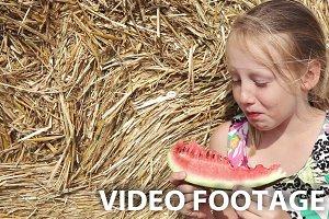 Girl eat watermelon