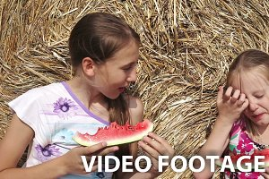 girls eating watermelon