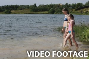 Young girls go into the water