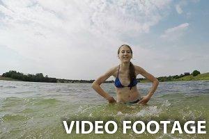 Young girl splashing the water