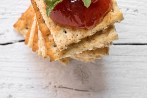 Pile of crackers with ketchup on top