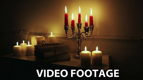 Old vintage books with candles in Graphics