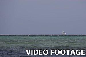 Sailboat floats on sea.