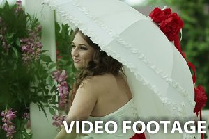 Young Bride with white umbrella