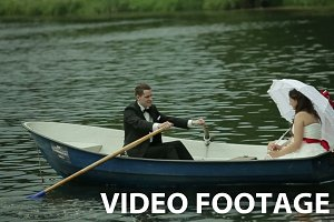 Wedding couple in rowboat.