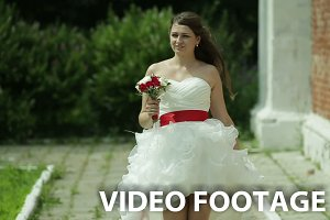 wedding dress with bouquet.