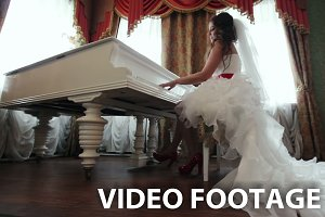 Bride playing the piano indoors