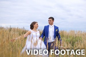 Bride and groom on a green meadow