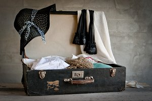 Open suitcase with old things