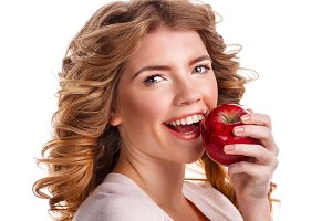 Girl with curly hair holding apple