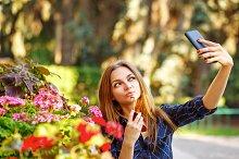 Girl doing self-portrait on phone