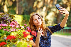 Girl doing self-portrait on phone