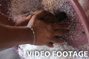 woman extraction of coconut pulp