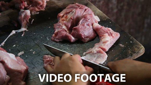 man's hand cut fresh meat