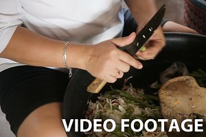 female hand cuts vegetables
