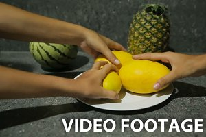 fresh tropical fruits on plate