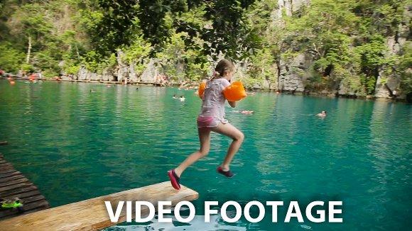 Girl jumping into the lake.