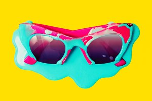 Pink Sunglasses dripping blue paint