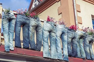 Group of blue jeans as flower pots