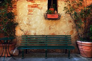 Retro bench outside italian house.