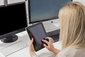 Woman in the office with tablet