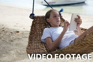 Girl in the hammock with the tablet