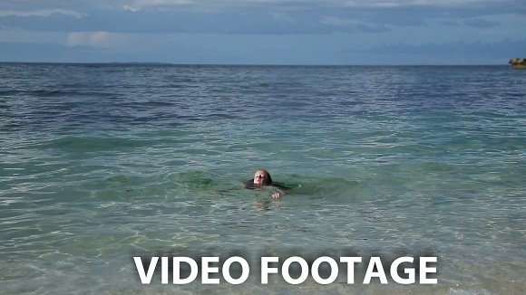 child swims in the tropical sea