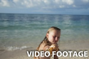 Child holding a seashell