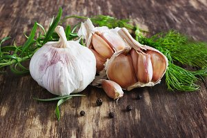head of garlic and herbs