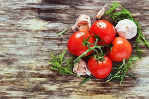 ripe tomatoes and herbs