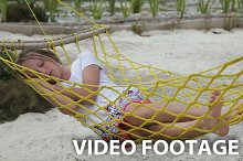 Young girl relaxing in a hammock
