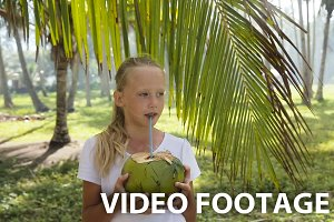 Young girl drinking coconut juice