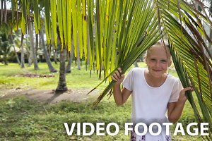 Young girl and coconut branch