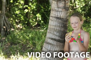 Young girl eating a banana fruit