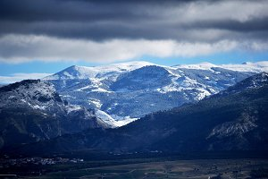 mountains with snow and clouds