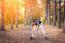 Beautiful sporty girl in forest