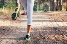 Runner feet. Running on road