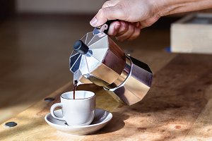 pouring espresso coffee in a cup