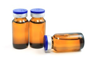 Three glass bottles with medicine