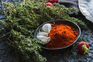 Aromatic herbs and garlic, paprika