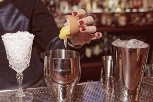 Bartender is adding egg to the glass