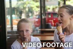 girls eating ice cream outdoors
