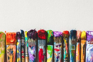 Row of artist paint brushes closeup