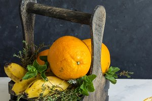 wooden box with oranges