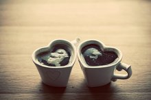 Coffee in two heart shaped cups.